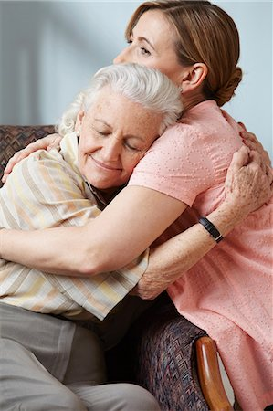 Daughter and senior mother embracing Stock Photo - Premium Royalty-Free, Code: 614-06043876