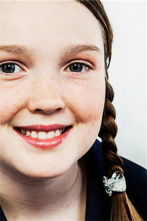 preteen girls faces photo - Girl with plaits Stock Photo - Premium Royalty-Free, Code: 614-06043885