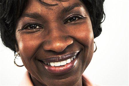 Mature woman looking at camera Stock Photo - Premium Royalty-Free, Code: 614-06043898