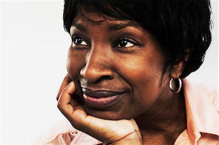 Mature woman looking away Stock Photo - Premium Royalty-Free, Code: 614-06043899