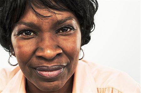 Mature woman looking at camera Stock Photo - Premium Royalty-Free, Code: 614-06043901