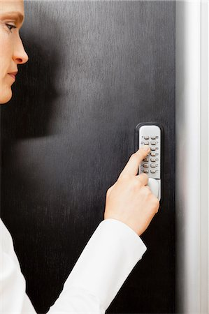 Woman pressing door keypad Stock Photo - Premium Royalty-Free, Code: 614-06043930