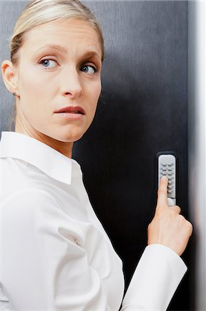Woman pressing door keypad Stock Photo - Premium Royalty-Free, Code: 614-06043931