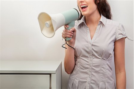 Young woman holding megaphone Stock Photo - Premium Royalty-Free, Code: 614-06043960