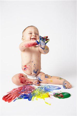 finger painting - Baby playing with paints Stock Photo - Premium Royalty-Free, Code: 614-06043996