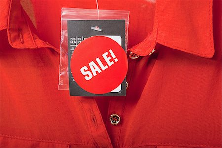 sale - Sale tag on red blouse Stock Photo - Premium Royalty-Free, Code: 614-06115986