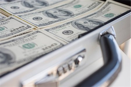 Briefcase with 100 dollar banknotes Stock Photo - Premium Royalty-Free, Code: 614-06116066