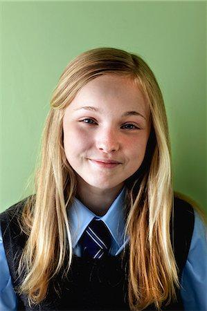 school girl uniforms - Schoolgirl smiling, portrait Stock Photo - Premium Royalty-Free, Code: 614-06116428
