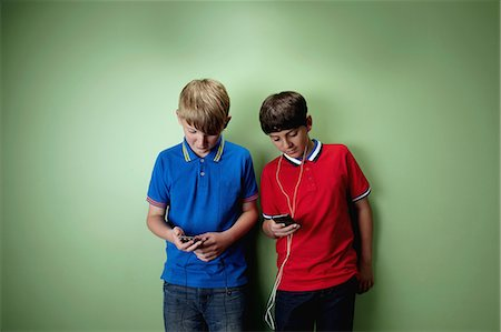 Two boys with mp3 players Stock Photo - Premium Royalty-Free, Code: 614-06116437