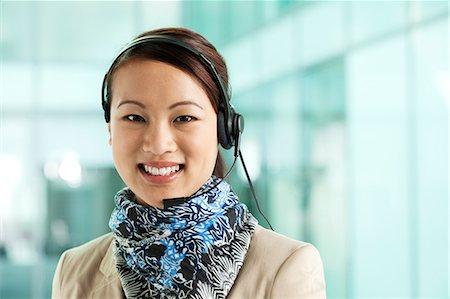 switchboard operator - Office worker wearing headset, portrait Stock Photo - Premium Royalty-Free, Code: 614-06116461