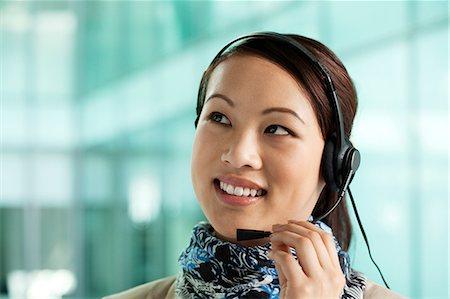 Office worker wearing headset Stock Photo - Premium Royalty-Free, Code: 614-06116514