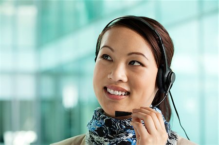 Office worker wearing headset Stock Photo - Premium Royalty-Free, Code: 614-06116514