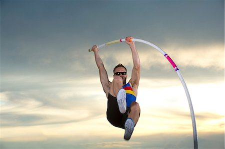 flexible (people or objects with physical bendability) - Pole vaulter Stock Photo - Premium Royalty-Free, Code: 614-06168620