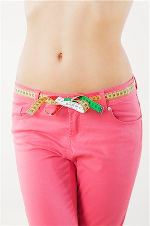slim - Young woman measuring waist with tape measure Stock Photo - Premium Royalty-Free, Code: 614-06168638