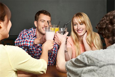 Friends toasting with soft drinks Stock Photo - Premium Royalty-Free, Code: 614-06168767