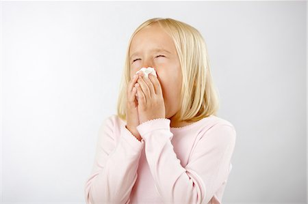 people coughing or sneezing - Girl with cold blowing nose Stock Photo - Premium Royalty-Free, Code: 614-06168869