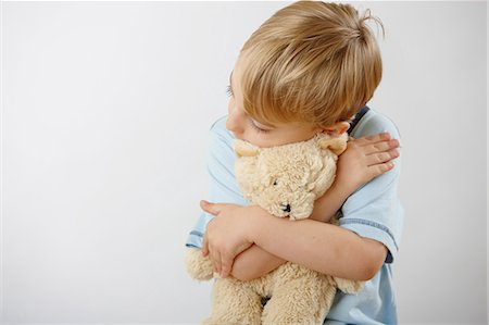 Boy hugging teddy Stock Photo - Premium Royalty-Free, Code: 614-06168878