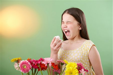 people coughing or sneezing - Girl with flowers sneezing Stock Photo - Premium Royalty-Free, Code: 614-06168873
