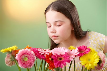 smelling - Girl sniffing flowers Stock Photo - Premium Royalty-Free, Code: 614-06168921