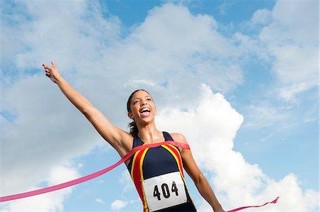 finish line - Female athlete crossing the finish line Stock Photo - Premium Royalty-Free, Code: 614-06168937