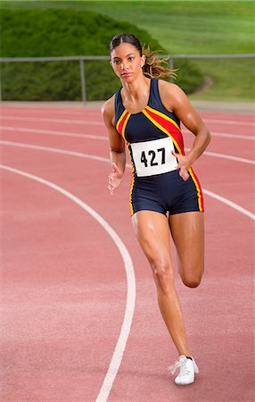Female athlete running on track Foto de stock - Sin royalties Premium, Código: 614-06168940