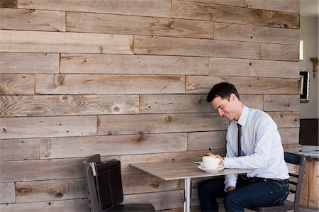 rustic - Businessman sitting at table in cafe Stock Photo - Premium Royalty-Free, Code: 614-06169066