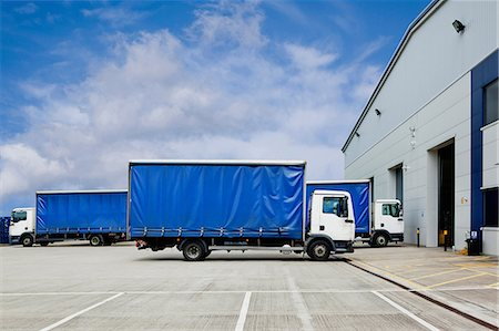 Trucks parked outside distribution warehouse Stock Photo - Premium Royalty-Free, Code: 614-06169100