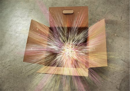 Open cardboard box with sparks Stock Photo - Premium Royalty-Free, Code: 614-06169134