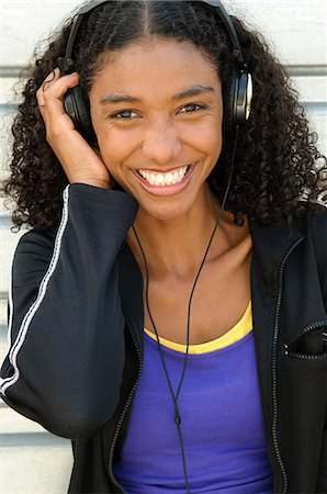Happy woman wearing headphones Stock Photo - Premium Royalty-Free, Code: 614-06169215