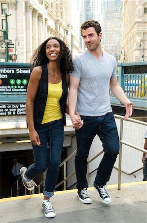 Couple exiting subway station Stock Photo - Premium Royalty-Free, Code: 614-06169217