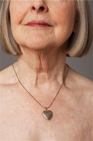 Senior woman wearing pendant Stock Photo - Premium Royalty-Free, Code: 614-06169269
