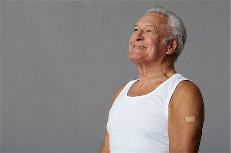 Senior man with plaster on arm Stock Photo - Premium Royalty-Free, Code: 614-06169276