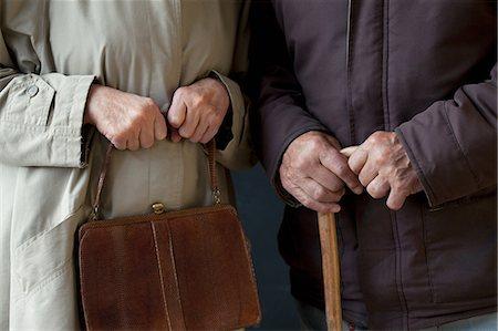 Senior man with walking stick, senior woman with handbag Stock Photo - Premium Royalty-Free, Code: 614-06169285