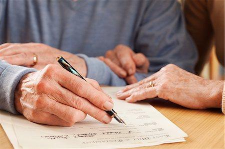 Senior man signing will Stock Photo - Premium Royalty-Free, Code: 614-06169296