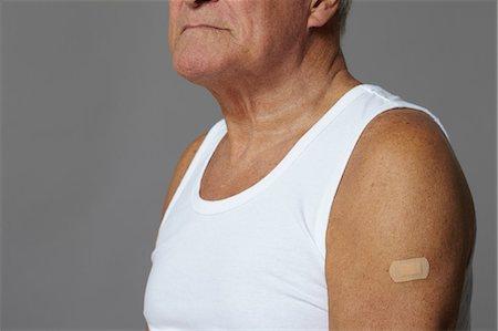 Senior man with plaster on arm Stock Photo - Premium Royalty-Free, Code: 614-06169302
