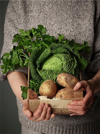 Woman holding wooden crate of vegetables Stock Photo - Premium Royalty-Free, Code: 614-06169319