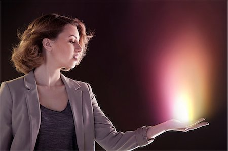 fire - Young woman with light in her hand Stock Photo - Premium Royalty-Free, Code: 614-06169427