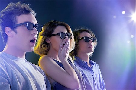 surprised - People in 3D glasses looking towards light Stock Photo - Premium Royalty-Free, Code: 614-06169438