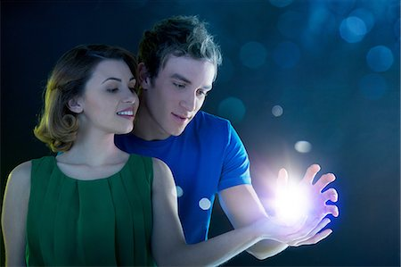 futuristic - Young couple holding light Stock Photo - Premium Royalty-Free, Code: 614-06169432