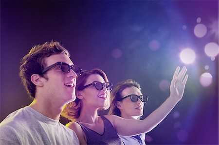 futuristic - People in 3D glasses looking towards light Stock Photo - Premium Royalty-Free, Code: 614-06169444