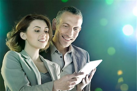 futuristic - Businesspeople looking at digital tablet Stock Photo - Premium Royalty-Free, Code: 614-06169441