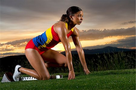 race track (people) - Female athlete on starting blocks Stock Photo - Premium Royalty-Free, Code: 614-06169455