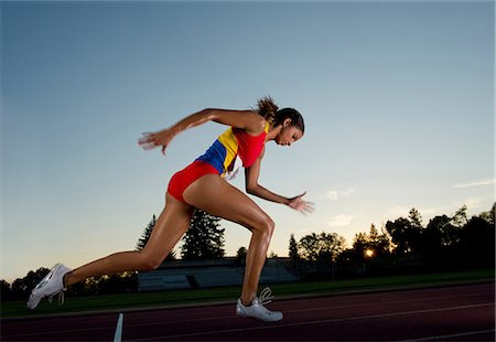 race track (people) - Female athlete running Stock Photo - Premium Royalty-Free, Code: 614-06169461