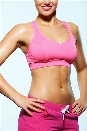 Body of a young woman wearing crop top Stock Photo - Premium Royalty-Free, Code: 614-06169478