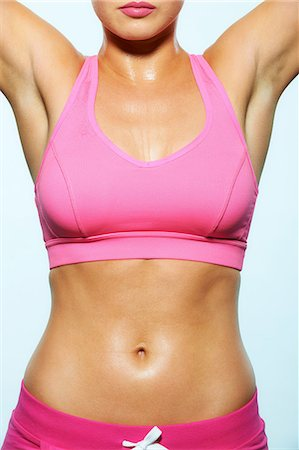 Body of young woman in workout gear Stock Photo - Premium Royalty-Free, Code: 614-06169518