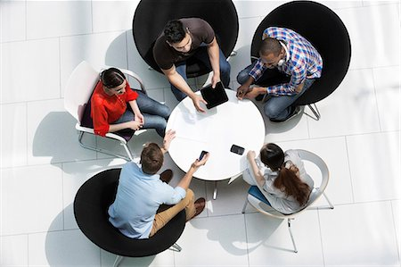 Overhead view of colleagues in meeting Stock Photo - Premium Royalty-Free, Code: 614-06169567