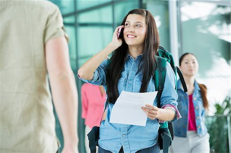 Young female backpacker in airport Stock Photo - Premium Royalty-Free, Code: 614-06169588