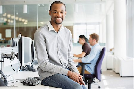 Young businessman in office Stock Photo - Premium Royalty-Free, Code: 614-06169580
