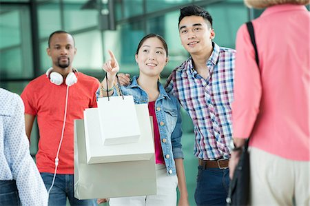 people on mall - Young couple in shopping mall Stock Photo - Premium Royalty-Free, Code: 614-06169607