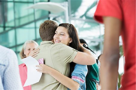 Young couple hugging in airport Stock Photo - Premium Royalty-Free, Code: 614-06169601